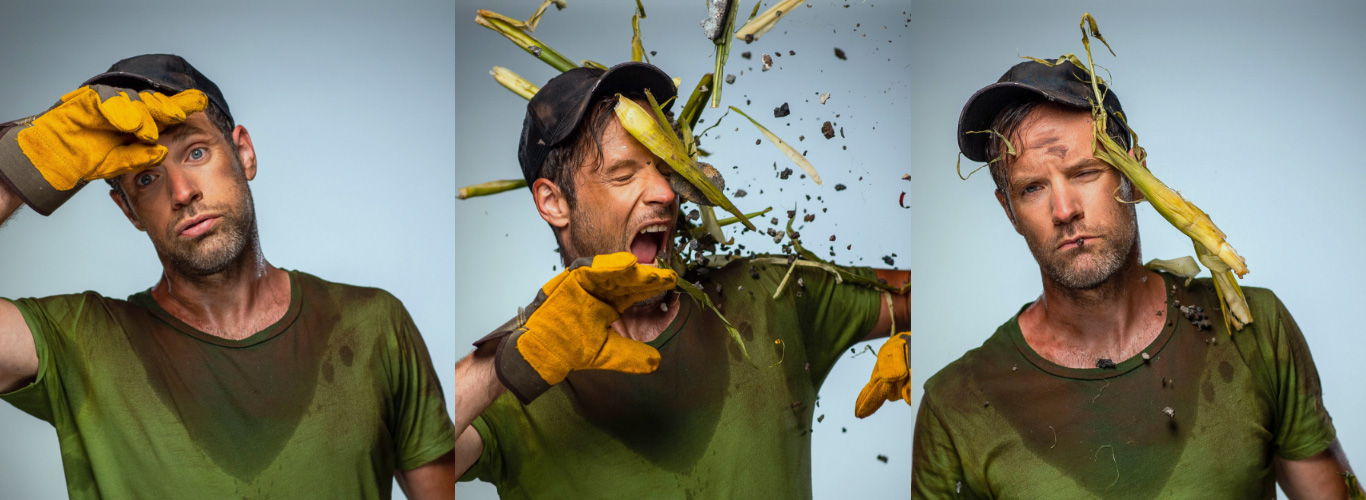 A series of three images of a man wearing a sweaty green t-shirt, ball cap and work gloves. In the first image he's wiping his brow and loks tired. In the second image bits of corn and rocks are flying at his face. In the third image he looks exhausted.