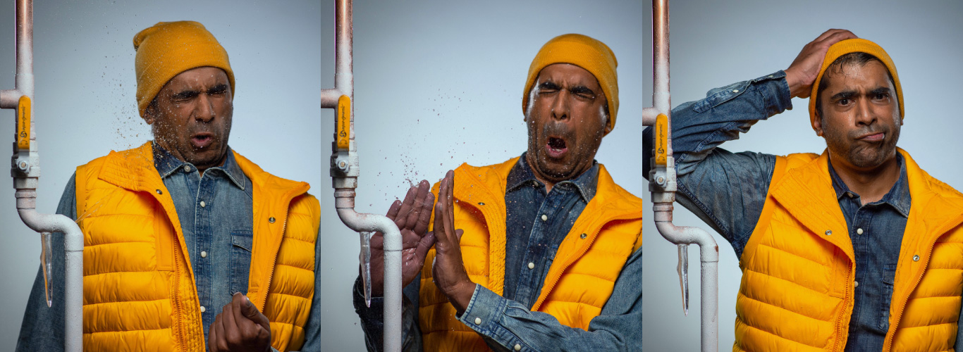 A series of three images of a man wearing a yellow vest and toque getting sprayed in the face from a broken frozen pipe.